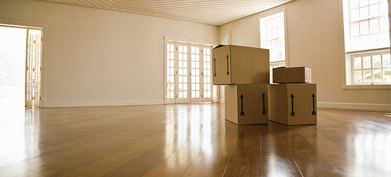 Boxes in an empty apartment.