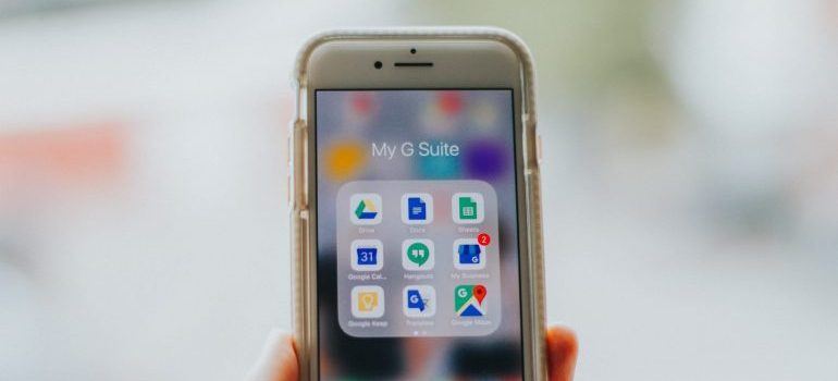 A mobile phone showing its apps on the screen
