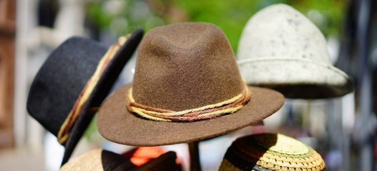 hats - organize a pre-move garage sale can be different