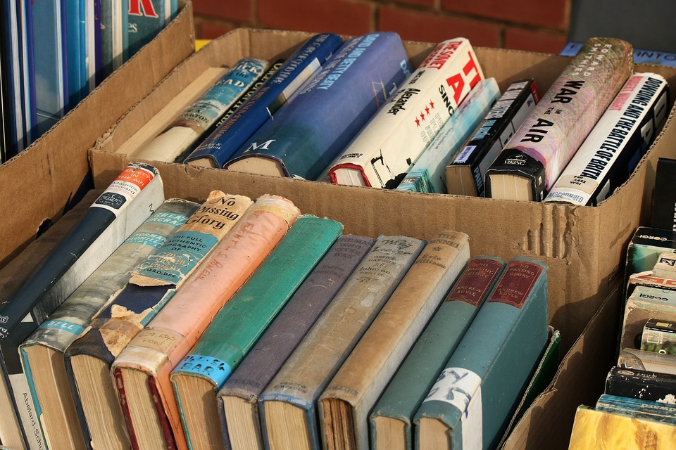 books in cardboard boxes