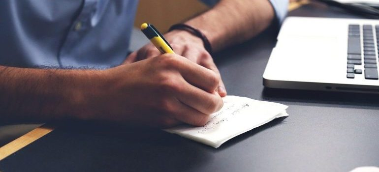 a man writing a list