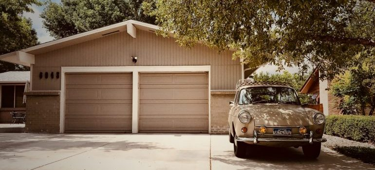 a car parked in front of a garage