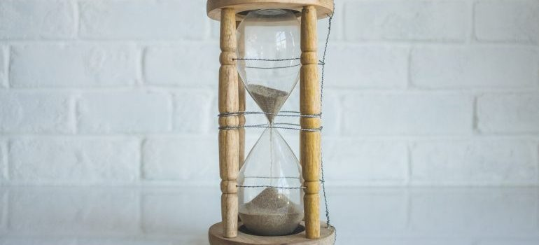 An hourglass can help you keep track of time when you need to pack for storage in a hurry