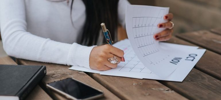 Woman taking notes in calendar