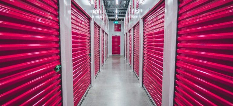 A storage facility with red doors.