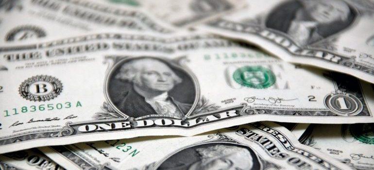 One dollar bills in a pile.
