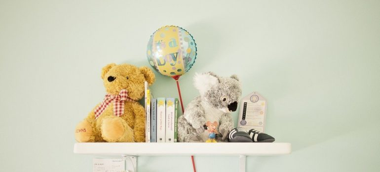 Picture of a shelf with plush toys. Installing shelves is one of the best toy storage ideas