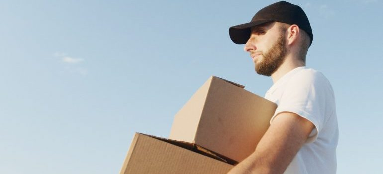 A mover holding boxes.
