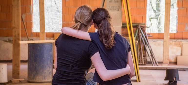 Picture of two women renovating their home. You should find storage units in Bethesda to speed up the renovation process