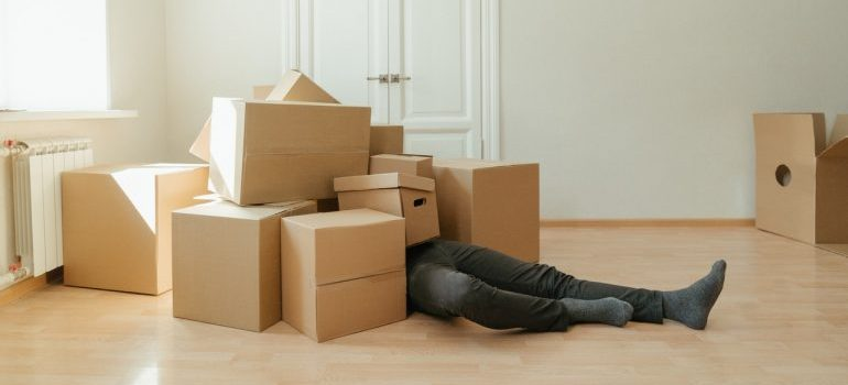 Picture of a man lying on the pile of cardboard boxes