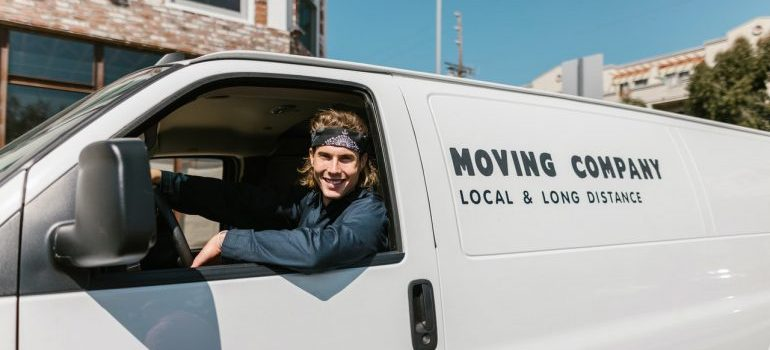 Picture of a moving professional driving a van