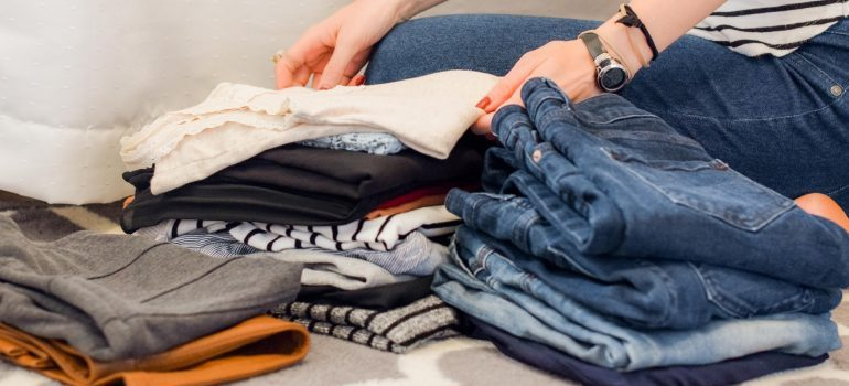 A woman unpacking and organizing her clothes