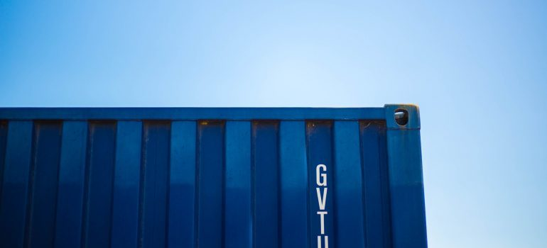 A part of a blue storage container