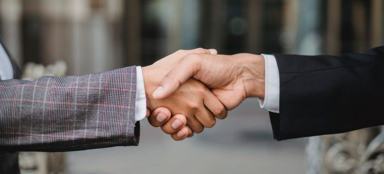 Man shaking hands after renting storage to use during military deployment