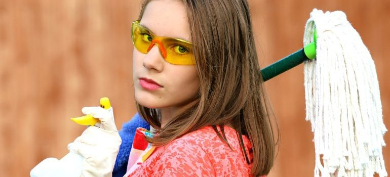 Girl with cleaning equipment