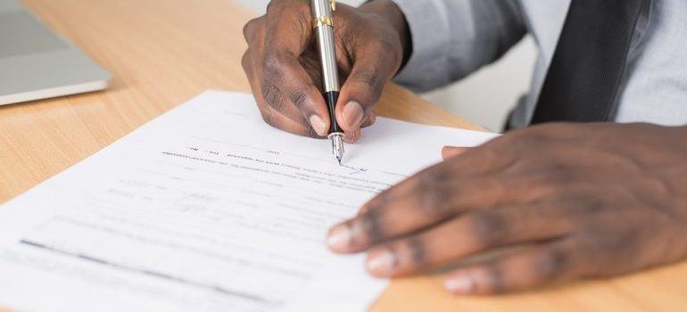 A contract signed by a man