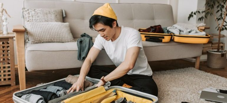 Picture of a man packing a suitcase