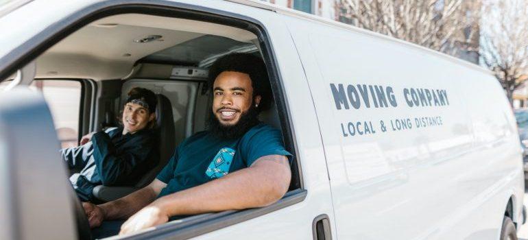 Movers inside a van