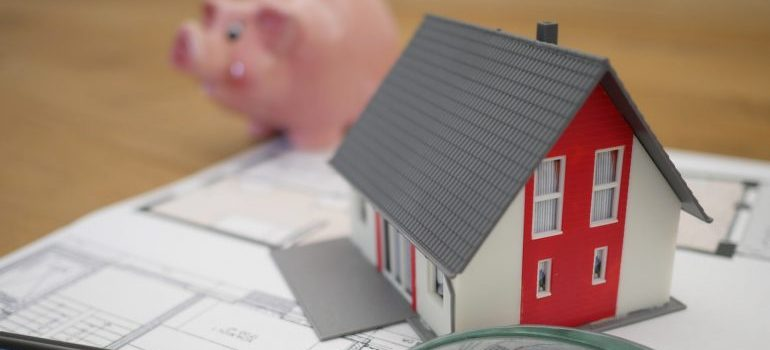 The model of a house and a piggy bank