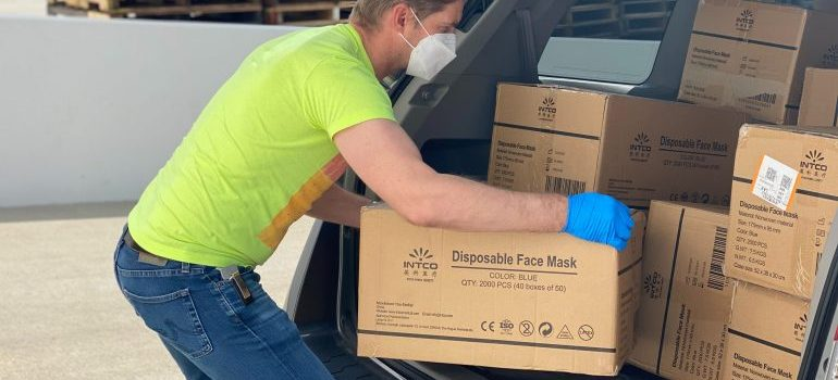 A man packing boxes for the move
