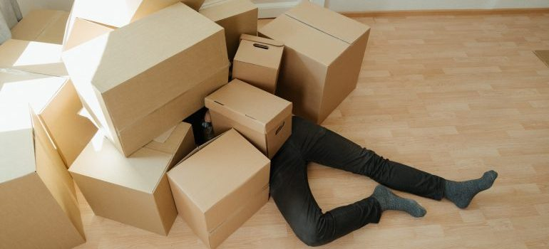 Man covered with boxes