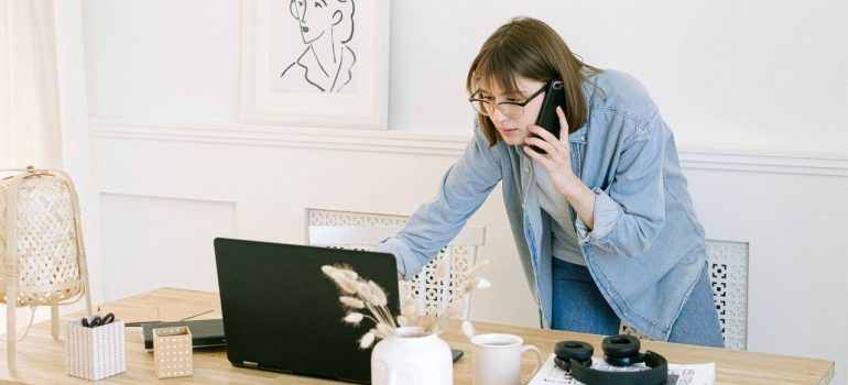a woman talking with people so she can notify before office relocation